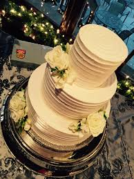 creme de la creme cake company white textured wedding cake