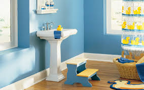amazing white pedestal sink on wood floors also blue bathroom