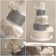 silver wedding cakes white three tier wedding cake with silver designs and black ribbon