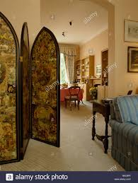 folding victorian decoupage screen separating traditional dining
