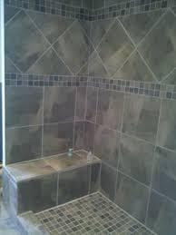 i like this shower gray tile tiny subway tiles built in shelves