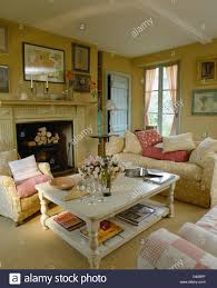 white coffee table in cosy country living room with armchair and