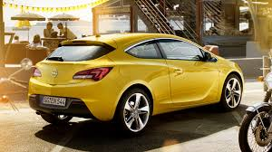 opel yellow opel astra gtc 2011 wallpapers and hd images car pixel