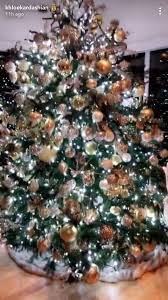 pictures of christmas decorations in homes khloé kardashian documents decorating her christmas tree people com