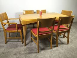mid century modern blonde dining table with 6 chairs by