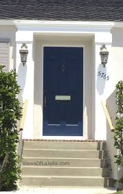 navy cobalt blue door white house add window boxes with red