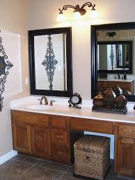 simple bathroom with white framed mirrors and simple framed wall