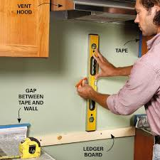 how to cut tile around cabinets how to tile a diy backsplash family handyman