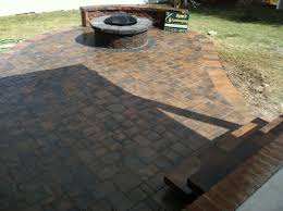 Installing A Patio With Pavers by Hanover Paver Patio Installation Featuring A Fire Pit With A Brick
