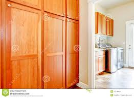 laundry room with wood storage cabinets stock images image