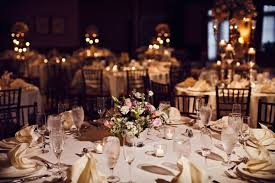 dim lights and lovely floral centerpieces for a wedding reception