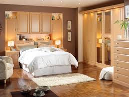 beige bedroom design featuring delectable wood closet furniture