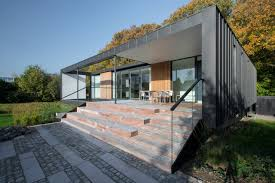 a villa in denmark located on the edge of a forest design milk