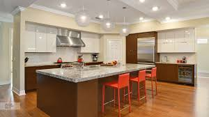 brown and white kitchen cabinets off white cabinets with a dark wood kitchen island omega
