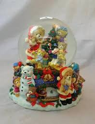 large musical christmas snow globe with teddy bears around