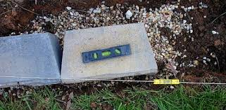 Gravel For Patio Base How To Level The Gravel Base For A Block Retaining Wall Today U0027s