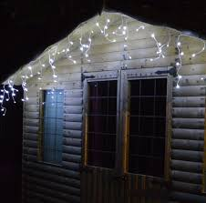 twinkling white led icicle lights lumineo led outdoor twinkle icicle lights 8 functions in a choice of