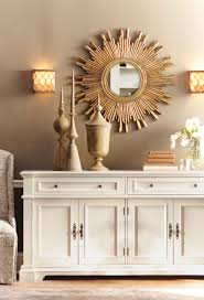gorgeous in gold this wall mirror is a statement making this wall mirror is a statement making centerpiece on any wall