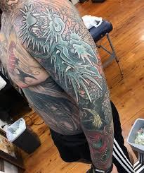 100 dragon tattoo cover up designs grey ink samurai helmet