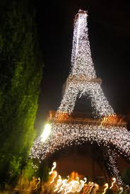 at 10 pm the eiffel tower light show begins and it is easily the