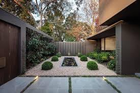 magnificent topiaries in entry traditional with tall planter pot