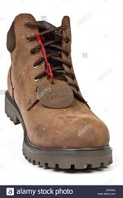 mens brown leather boots with a red label strings stock photo