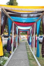 indian wedding outdoor walkway at wedding house decorated using