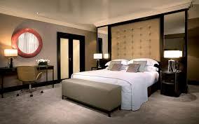 bedroom black fabric area rug beige drawer nightstand shape table