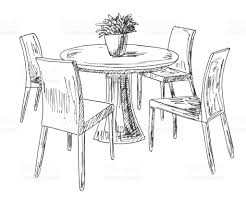 part of the dining room round table and chairson the table vase of