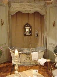 shabby chic style bathroom with freestanding tub and mirror and