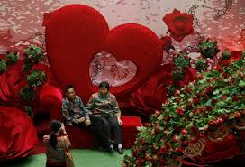 Happy Valentines Day Decor by A Vendor Arranges A Heart Shaped Rose Bouquet While Waiting For