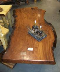 furniture enjoying a cup of coffee with a tree stump coffee table