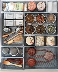 organize your kitchen cabinets in 11 easy steps martha stewart drawer organizers