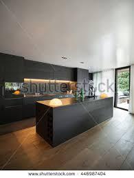 www kitchen furniture modern kitchen black furniture wooden floor stock photo 446987404