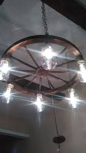 Wagon Wheel Lighting Fixtures Handcrafted Rustic Wagon Wheel Light Fixture For The Home
