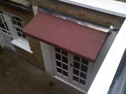 a detailed look at flat roofs and how much they cost to replace