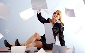 Sitting On The Desk Blonde Throwing White Sheets Of Paper Sitting On The Desk