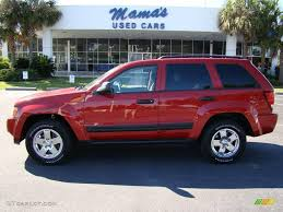 silver jeep grand cherokee 2006 2006 inferno red crystal pearl jeep grand cherokee laredo