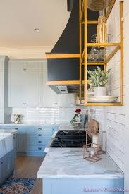 how to accessorize a grey and white kitchen kitchen white marble calcutta gold open shelves gold black