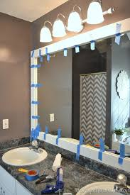 framing bathroom mirror ideas how to frame out that builder basic bathroom mirror for 20 or less