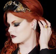 ashley of hollywood noir makeup wearing a steunk inspired gold and brown smokey eye