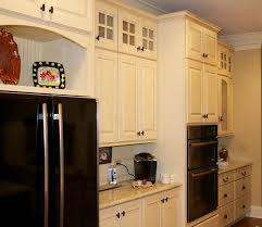Kitchen Beadboard Backsplash by Jeffrey Alexander Hardware Kitchen Traditional With Brick