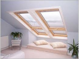 modern and laconic seating area by the attic window make room