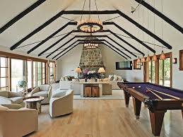 the vaulted ceiling with exposed beams sets the stage for the
