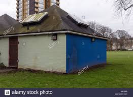 blue and green painted walls at back of public toilet block on