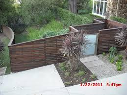 captivating front yard garden decoration using light oak wooden
