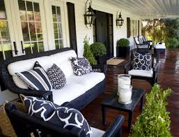 black wicker outdoor furniture with sitting area transitional porch