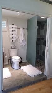 Small Bathroom Closet - bathroom bathroom with over toilet towel storage hanging on white