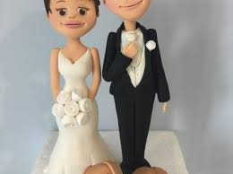 and groom figurines cakes by georgiou groom cake toppers