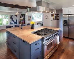 range in island kitchen a chef s grade stainless steel range and cooktop nestle into the